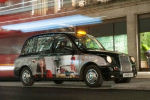 Black Cab with Advertising Wrap